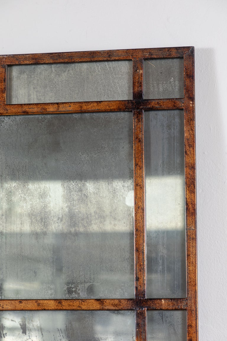 Aged brass frame with antiqued smoked glass mirror.