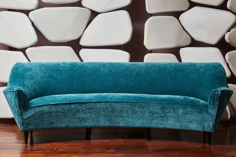 Vintage sofa entirely restored and reupholstered with a blue fabric by Rubelli. 8 black painted wooden feet.  Designed by Ico Parisi, Italy, 1970s.