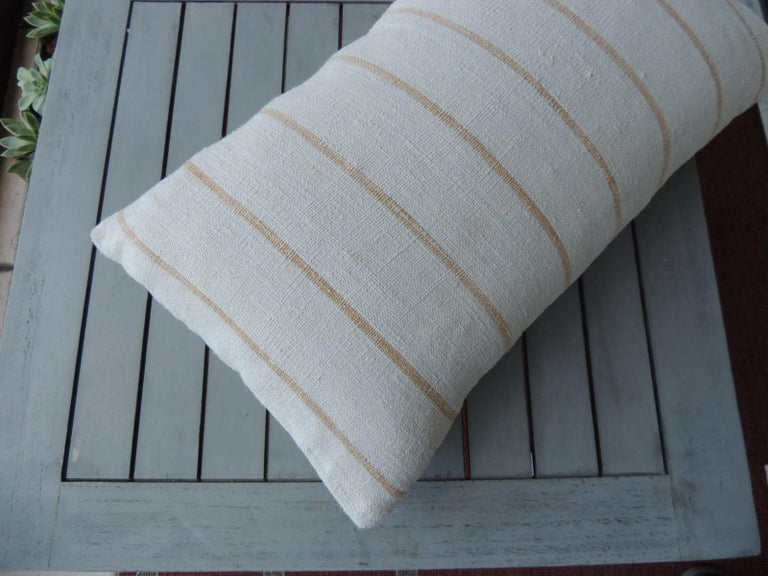 Vintage soft yellow stripes grain sack linen decorative lumbar pillow with natural cotton backing. Decorative pillow handcrafted and designed in the USA.  Closure by stitch (no zipper closure) withcustom made pillow insert. Size: 11