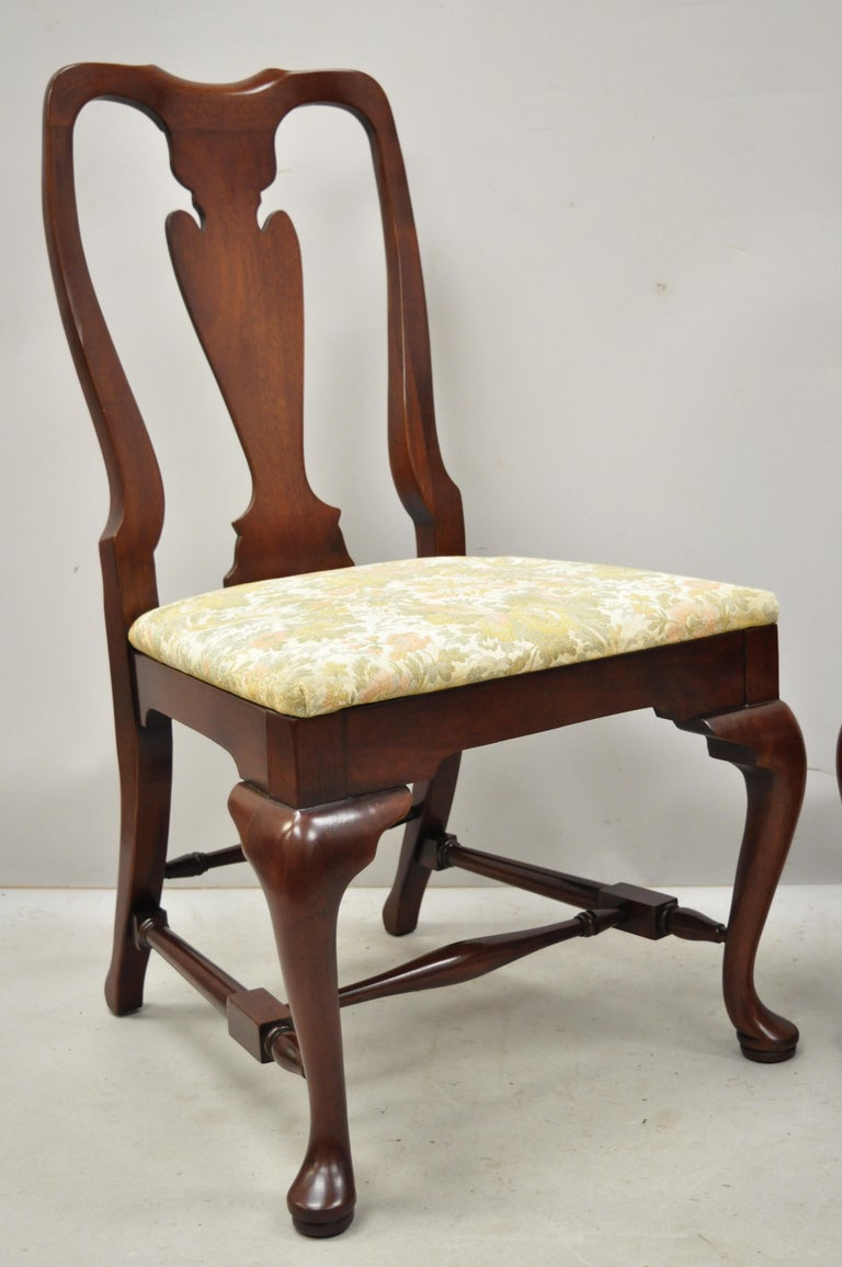 Vintage solid cherrywood queen Anne style stretcher base dining side chairs. Item features solid wood construction, beautiful wood grain, shapely queen Anne legs, quality American craftsmanship, circa mid-late 20th century.Measurements: 38