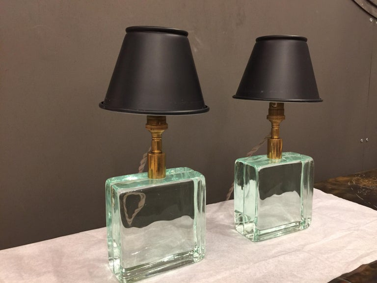 In the manner of Fontana Arte, these Italian petite solid glass brick lamps are finished with vintage black metal shades. Newly rewired for US with silk cable. They are fun!  NOTE: We kept the original Bayonet European sockets - light bulbs can