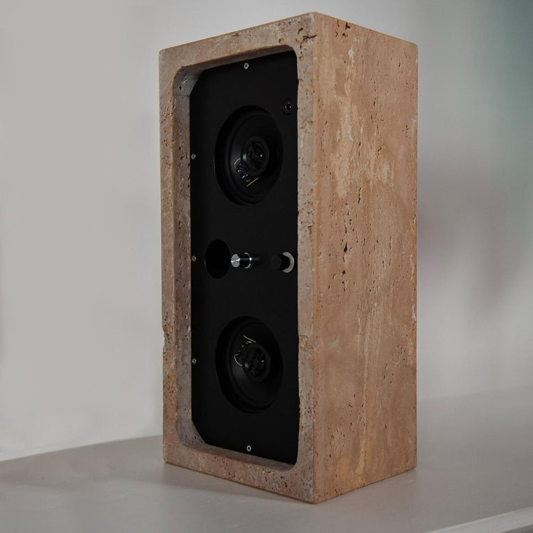 Perfectly suited for a contemporary or industrial-inspired decor, this powerful 30W-vintage sound stereo delivers clear, distinct sound in a compact design that embodies simplicity and elegant minimalism. A rectangular case crafted of Travertine