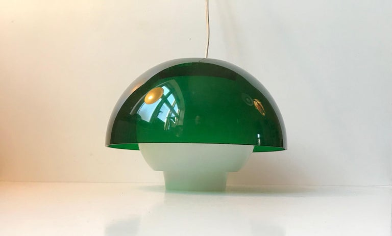 Model Ergo plexiglass pendant lamp designed by Bent Karlby and manufactured by ASK Belysninger in Denmark in the 1970s. This is one of two listed.