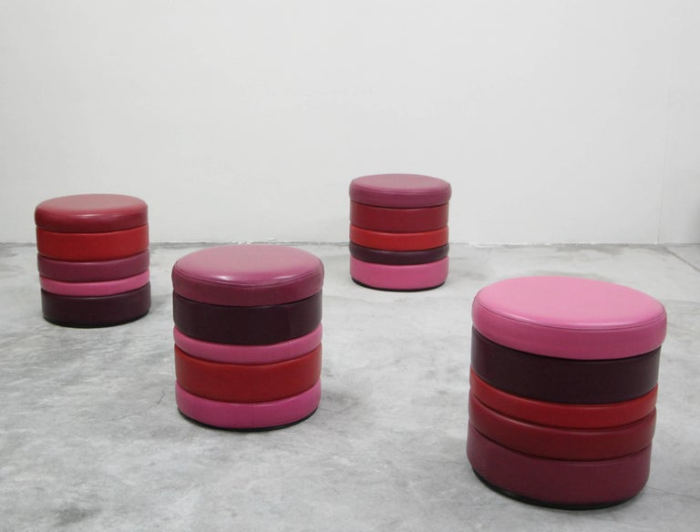 The options are limitless with this set of four, all original vintage stacked colorful vinyl stools. Fun and playful, ready for your own custom color scheme to match your next project. Perfect in vibrant colors for a playroom or child's room, or