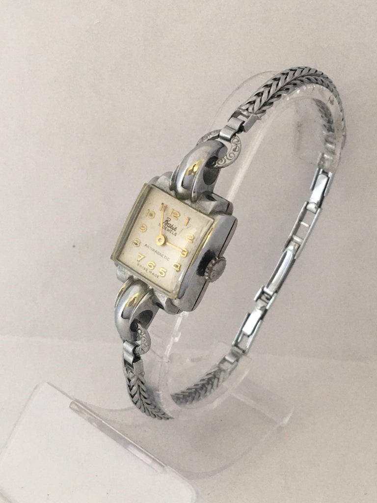 This beautiful pre-owned vintage hand winding ladies watch is in good working condition and it is ticking nicely and runs well. It measure 7 inches long around the wrist.