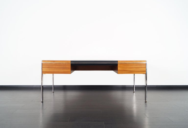 Exceptional vintage executive desk designed by Richard W. Thompson for Glenn of California in the United States, circa 1970s. This rare desk features three drawers, a solid stainless steel frame, and leather top. On the opposite side of the desk