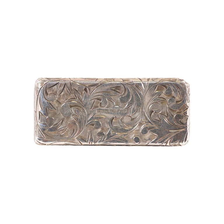 Sterling cigarette case with scrolled leaf design. Marked Sterling 9.70. Art deco style with intricate leaf design.   PERIOD: Late 19th - Early 20th Century  ORIGIN: United States  SIZE: 2 1/4 x 1