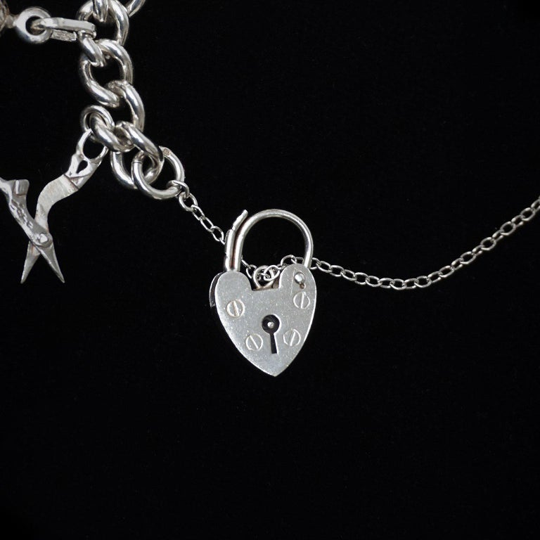 British Vintage Sterling Silver English Padlocked Charm Bracelet with Seventeen Charms