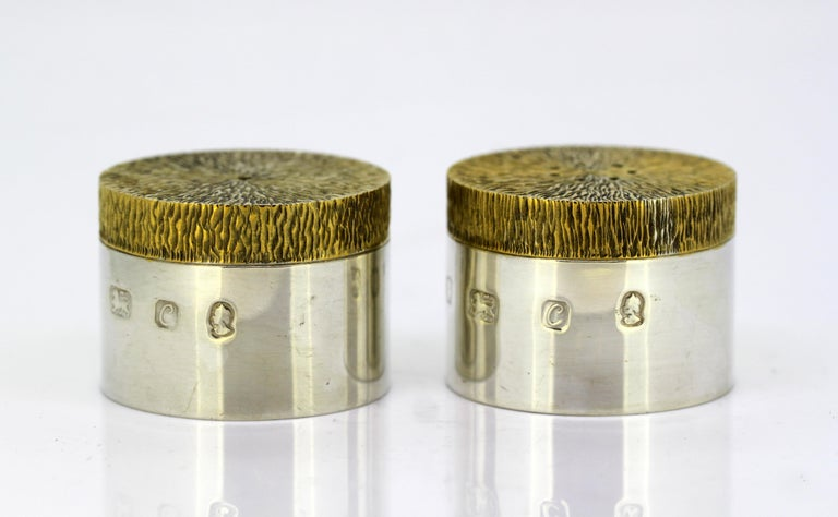 Vintage sterling silver salt and pepper shakers Maker: JH (Unidentified) Made in London 1977 Fully hallmarked.  Dimensions -  Diameter x height: 4.5 x 3.3 cm Weight: 110 grams total  Condition: Shakers are pre-owned, have surface wear and
