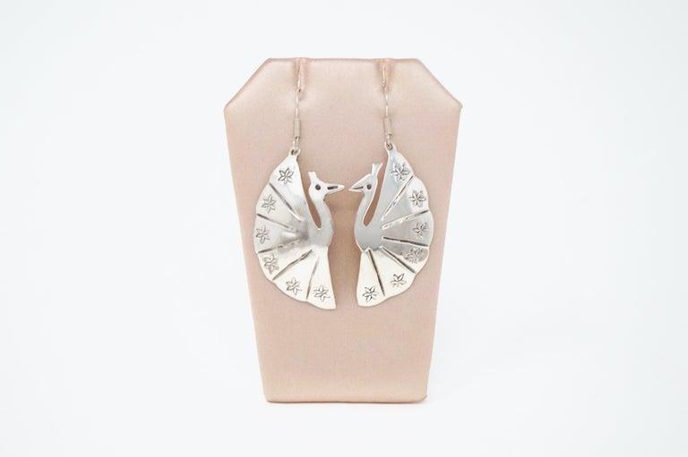 - Each earring measures 2
