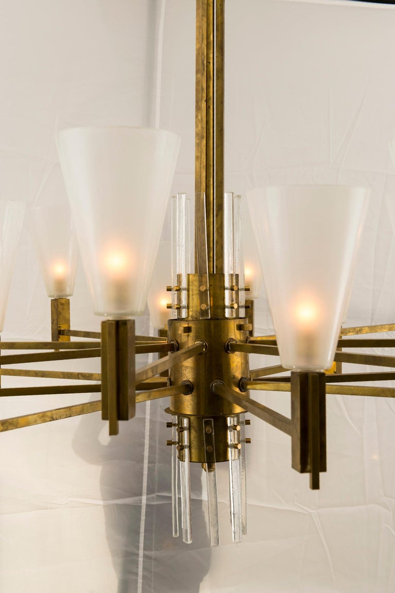 A massive and handsome vintage Stilnovo style 16 light solid brass and glass chandelier from Milan, newly electrified.