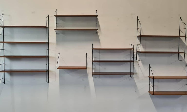 Vintage modular book shelves by String.  Metal supports and oak shelves.  Good condition, completely modular  1960s - Denmark  *Sold as a set, price is for the complete set  Dimensions vary in size.