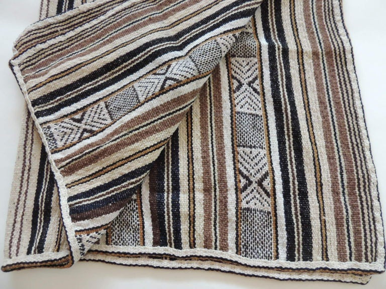 Vintage stripes and tribal design woven throw.