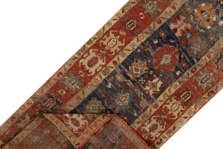 Vintage hand-knotted Persian Bakshaish Runner with a navy-blue field, the frame of rust, and beige accents in all-over tribal design. This piece has fine details, great colors, and a beautiful design.  This rug measures 3'11