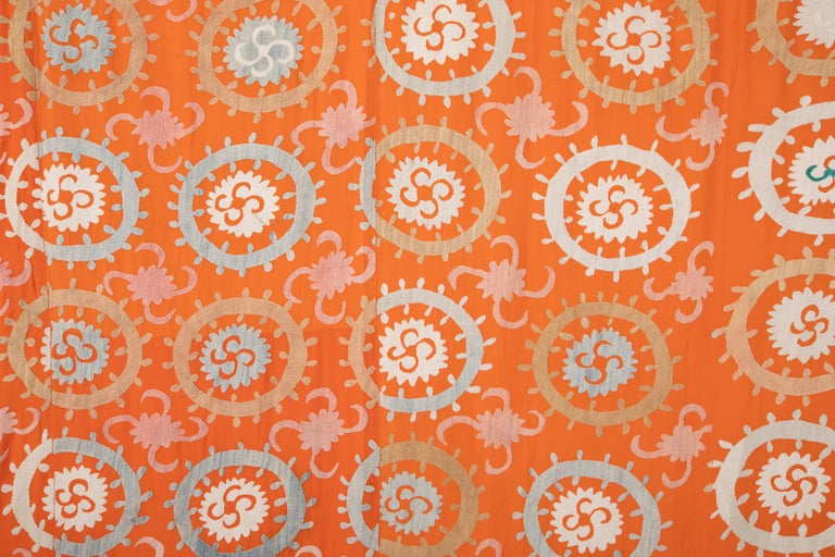 The design and work on this orange Suzani is superior to the most same period pieces. It has no lining and if one wants to use it on a bed or so it could use one and it can be done upon request.