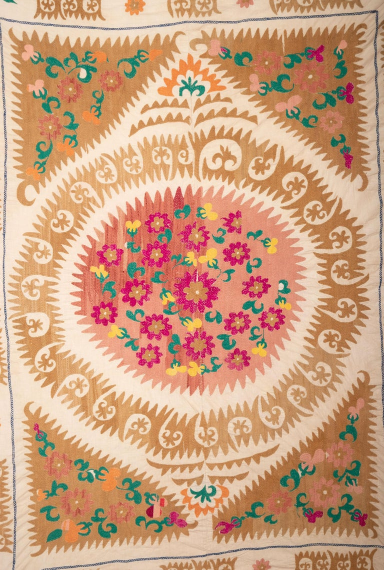It is unusual with its bold design and smaller size. This group of Samarkand suzanis tend to be either very large or very small, this is in between.