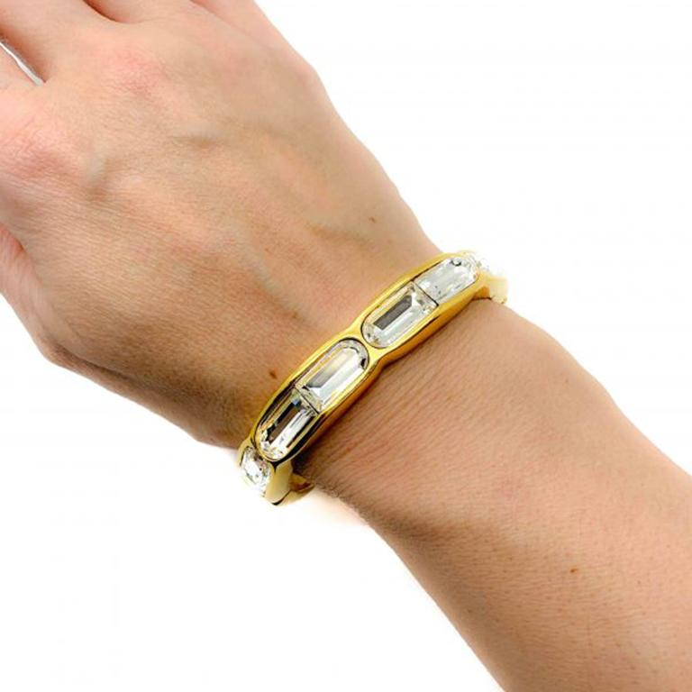 What a beauty! A substantial and super stylish Vintage Swarovski Bangle. One of the best examples of a Swarovski cuff around. Bold and beautiful. Featuring six incredible fancy cut Swarovski crystals in a high quality gold plated bangle. This cuff