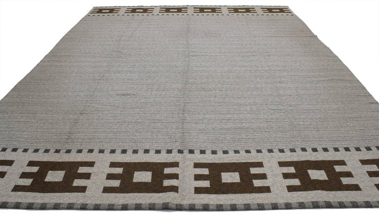 77037, vintage Swedish Kilim rug with Scandinavian Modern style - Rollakan flat-weave rug. This handwoven wool vintage Swedish Kilim rug with Scandinavian Modern style features an abrash gray striated field. It is enclosed with coffee colored bands