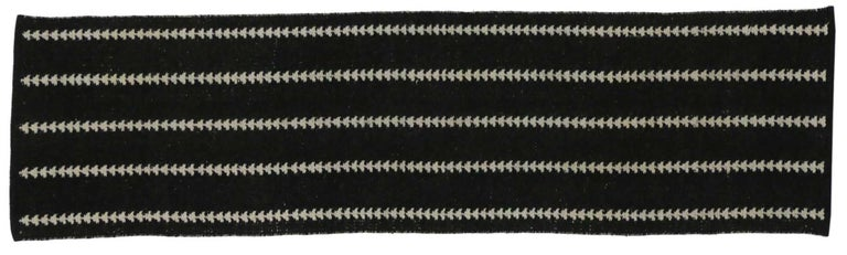 76714, vintage Swedish Reversible Kilim runner with Scandinavian modern style. This handwoven vintage Swedish reversible Kilim runner with Scandinavian modern style features five vertical columns of arrows in a reversible design of black and beige.