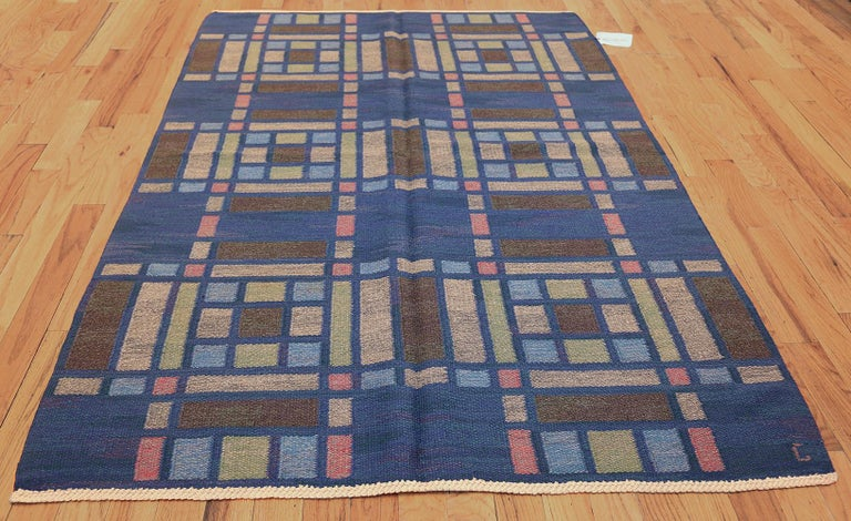 This splendid vintage Scandinavian Kilim features a striking compartmental composition with strong right-angle subdivisions. The elegant cobalt blue field and leaded lines feature subtle variegated textures that incorporate deep ultramarine blues