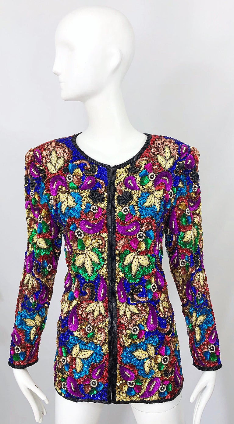 Wonderful vintage 90s SWEE LO fully sequined, beaded and pearl encrusted stained glass silk jacket! Features thousands of hand-sewn sequins, beads and pearls throughout. Hidden hook-and-eye closures up the front. Literally every color in the rainbow