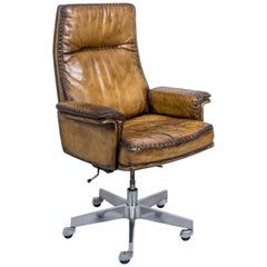 Vintage Swiss De Sede DS 35 Executive Leather Swivel Armchair on castors, 1960s