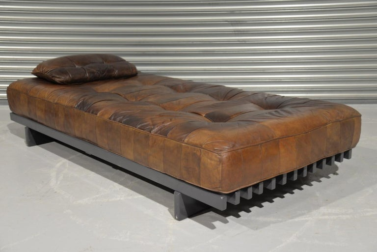 Discounted airfreight for our US Continent customers (from 2 weeks door to door)  We are delighted to bring to a rare De Sede DS 80 patchwork leather daybed with patchwork cushion. Hand built in the 1960s by De Sede craftsman in Switzerland, the