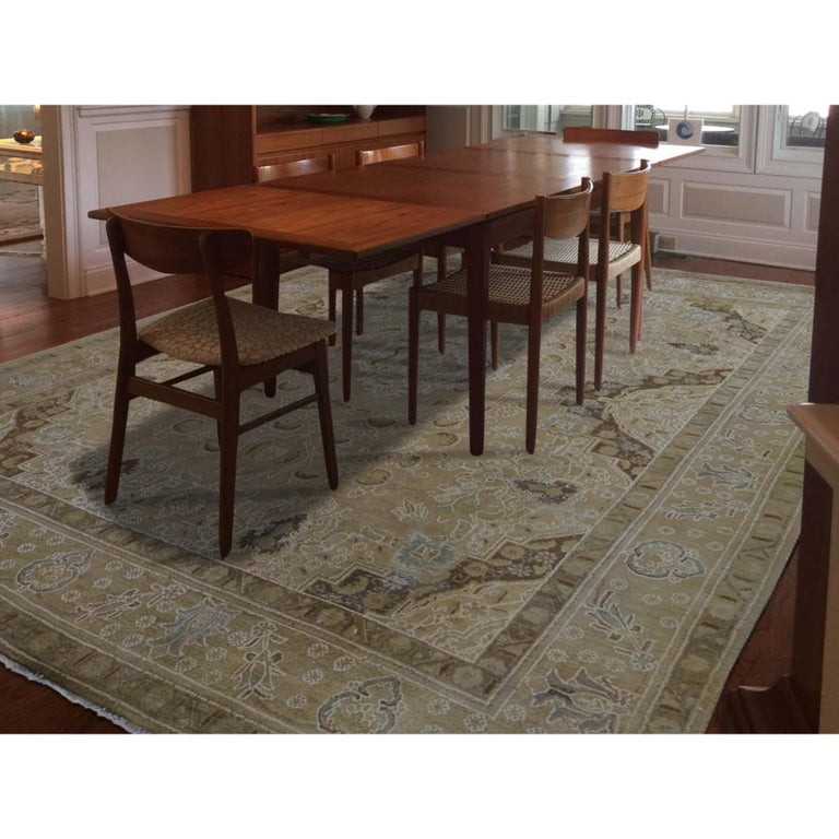 This is a truly genuine one-of-a-kind vintage Tabriz hand knotted pure wool oriental rug. It has been knotted for months and months in the centuries-old Persian weaving craftsmanship techniques by expert artisans. Measures: 10'1