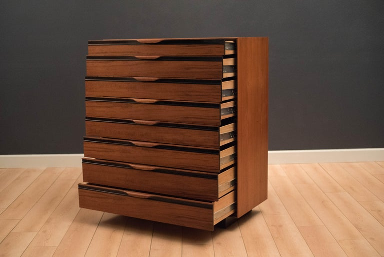 Mid-Century Modern highboy dresser chest designed by John Kapel for Glenn of California in walnut. This piece is equipped with eight storage drawers that glide smoothly on metal slides. Includes four adjustable drawer dividers.