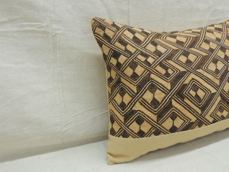 Vintage tan and brown African Kuba decorative bolster pillow with texture Yellow frame and same yellow linen backing. Decorative pillow handcrafted and designed in the USA. Closure by stitch (no zipper closure) with custom made pillow
