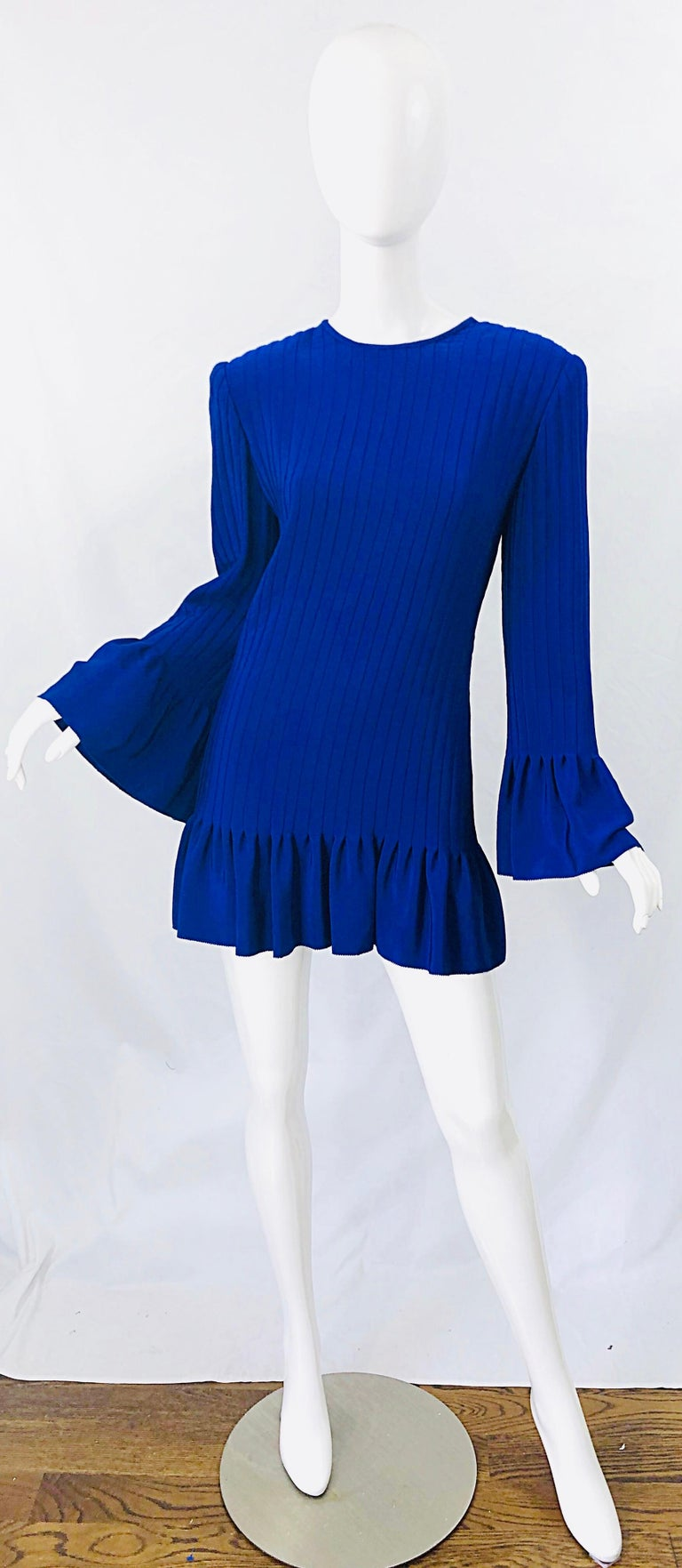 Chic early 1980s TARQUIN EBKER royal blue silk pleated mini dress or tunic top ! Ebker was a high society designer throughout the 60s, 70s, 80s and 90s. His work was known to be couture quality, with heavy attention to details. Hidden zipper up the
