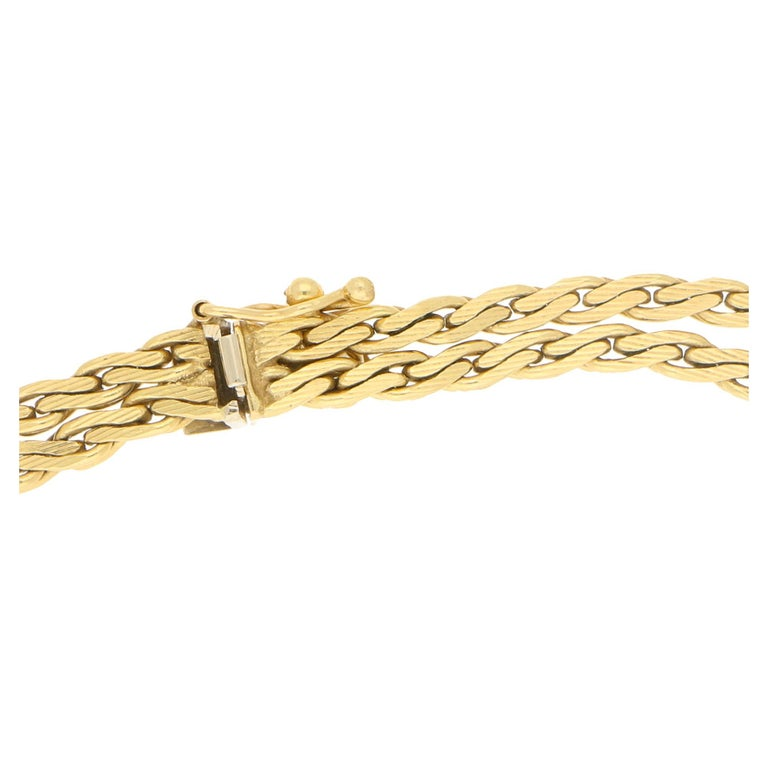 A vintage necklace in the form of a looped over tassel rope.  Crafted in a rich tone of 18k yellow gold, this vintage necklace is both elegant and timeless.  The tassels are detailed terminating in fine chains which allows a playful movement. The