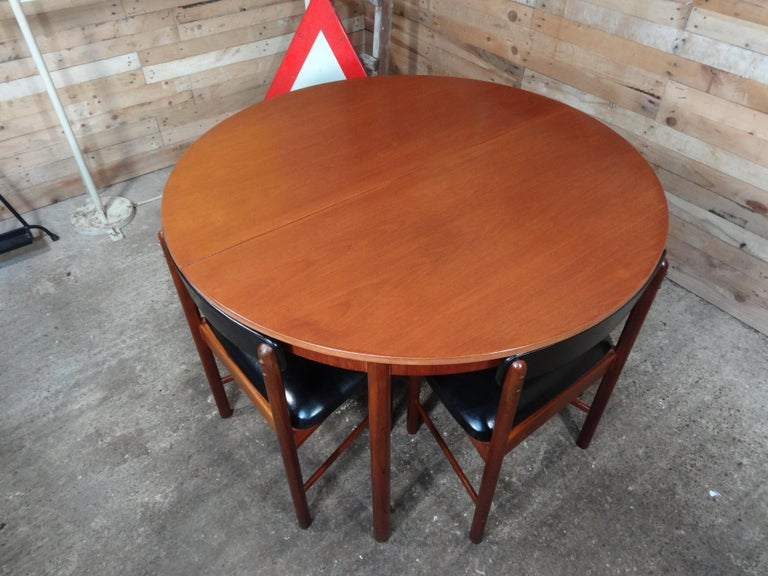 Vintage teak foldout dining table 4 chairs by Tom Robertson for McIntosh, 1960  4 English McIntosh chairs and teak (extendable) table  McIntosh table and 4 chairs, very similar to the Frem Rojle dining table chair set, chairs of this set fit
