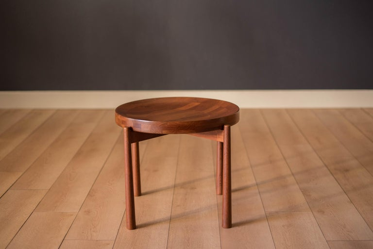 Mid-Century Modern round tray table manufactured by Dux of Sweden. This side table is made of solid planked teak that features a reversible concave and flat top.  Table top 19.5