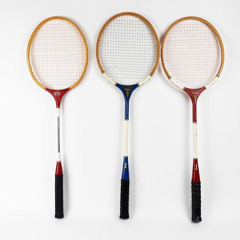 Vintage set of three tennis rackets in red white and blue. This would make a great focal point hung on a wall or perhaps for using them for their intended purpose!  Measures: 25.75