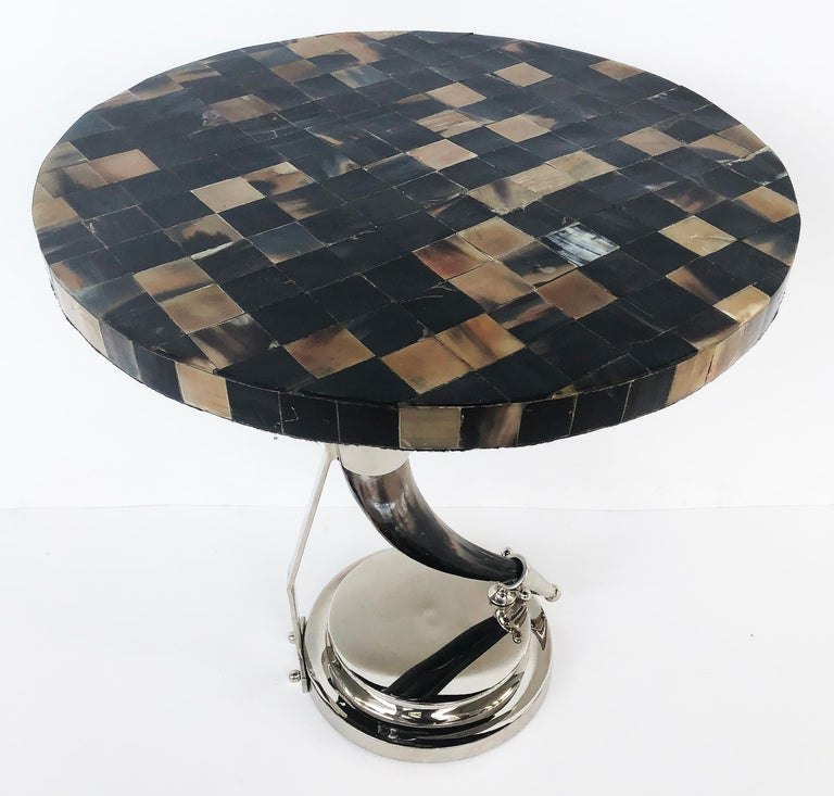 Vintage tessellated horn and chrome occasional table  Offered for sale is a tessellated horn topped occasional table supported by a polished steer horn and chrome base. This is a very stylish and unusual table that was custom-crafted.