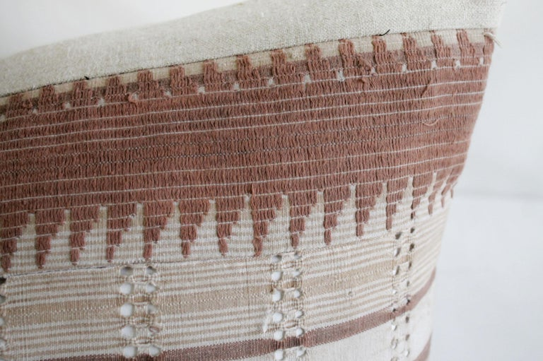Vintage textile and Belgian linen lumbar pillow The face of the pillow is made from vintage cotton textile in a mauve and natural linen fabric. The back side is in natural linen, with a hidden zipper closure. Measures: 17