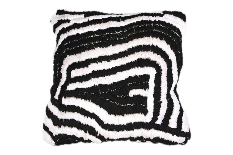 Floor pillow made from vintage Moroccan rug sourced in Marrakech.