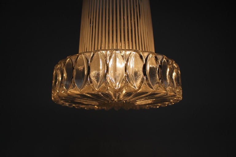 Very rare German origin midcentury large textured glass pendant lamp attributed to Aloys Gangkofner by Peill & Putzler. Very elegant 1950s design. Made of very thick patterned glass. Makes a great charming light and is very decorative in any