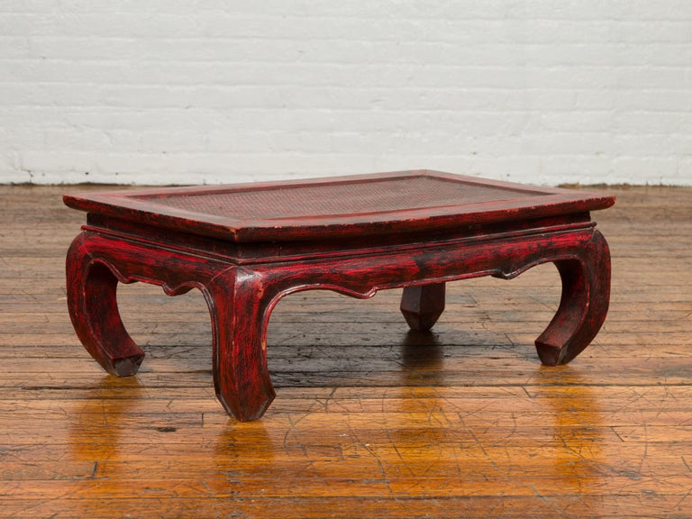 Lacquered Vintage Thai Red Lacquer Waisted Coffee Table with Rattan Inset and Chow Legs For Sale