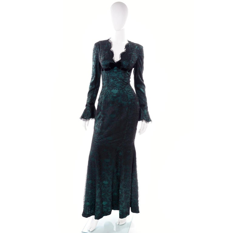 This is an absolutely outstanding dramatic vintage mermaid style green evening dress from Thierry Mugler. This gorgeous evening gown is full length with a low scalloped V neck with a bow.  The green silk dress has a lace & velvet overlay.  We
