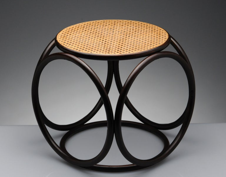 Appealing circular designed stool by Thonet. Sculptural and versatile design, can be used as a side table or ottoman as well.