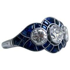 Vintage Three-Stone Diamond Ring Sapphire Halo Engagement Ring in Platinum