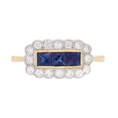 Vintage Three-Stone Sapphire and Diamond Cluster Ring, circa 1950s