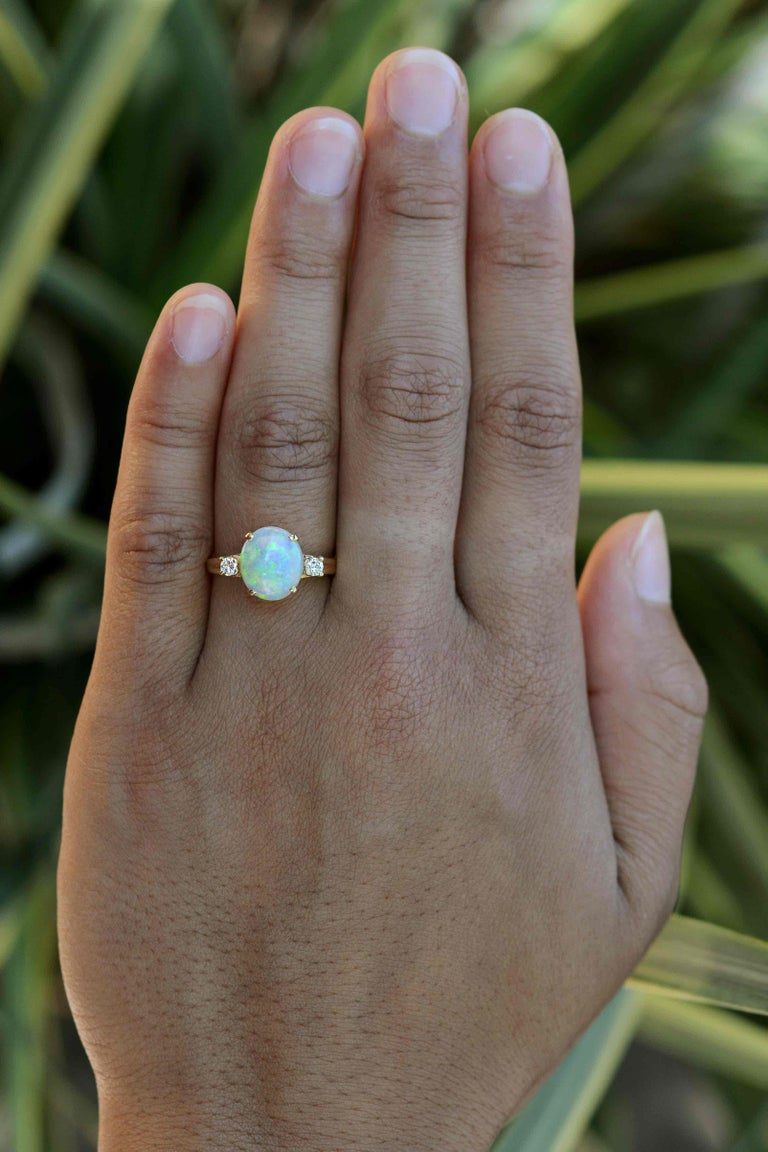You'll enjoy this classic, vintage Tiffany 3 stone opal and diamond engagement ring for generations to come. The simple, Mid Century trinity or trilogy design can be worn as a bridal jewel, birthstone or statement ring. Centering on a kaleidoscopic