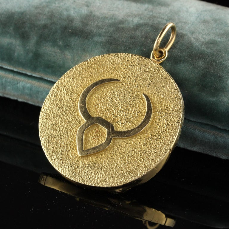 Beautiful Vintage Tiffany and Co 18K Yellow Gold Taurus Zodiac Pendant. This incredible pendant is large and very heavy! It is in excellent condition and is part of their iconic collection.  Item #N0054  Metal: 18K Yellow Gold  Weight: 52.3