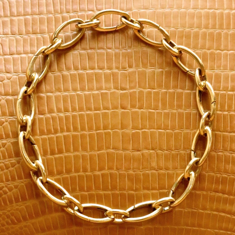 Classic and timeless, this vintage Tiffany & Co. bracelet is a perfect everyday accessory. Wear it with jeans and sweater or a beautiful evening dress; you will not go wrong. Alternating opening elongated oval links. Hallmarked Tiffany & Co, Italy.