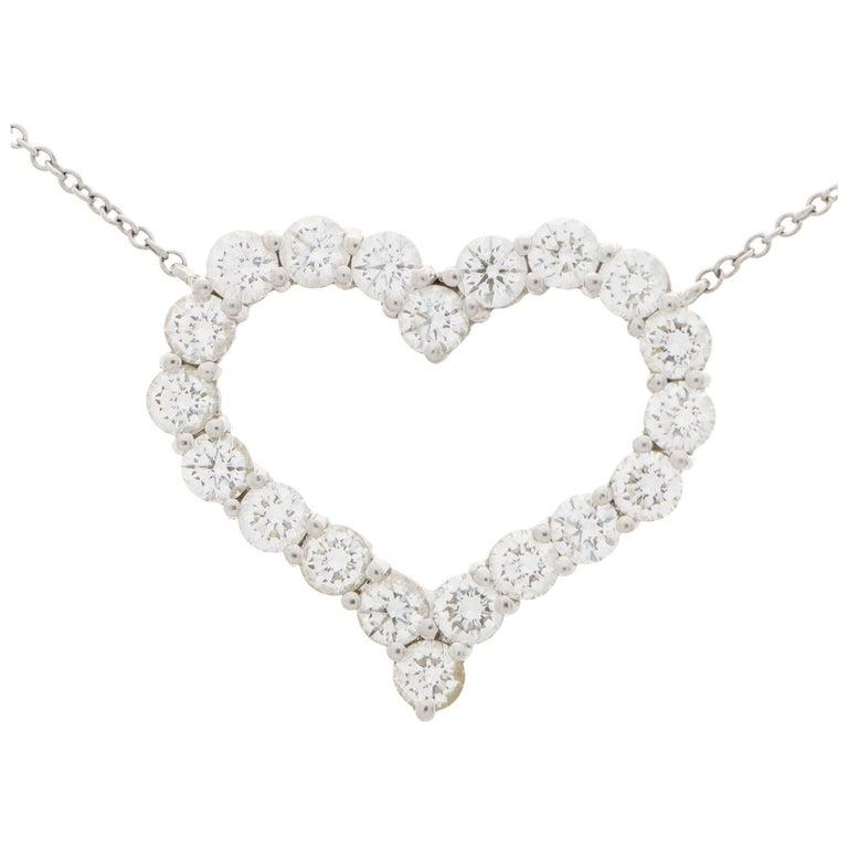 Vintage Tiffany & Co. Diamond Heart Pendant Necklace Set in Platinum For Sale