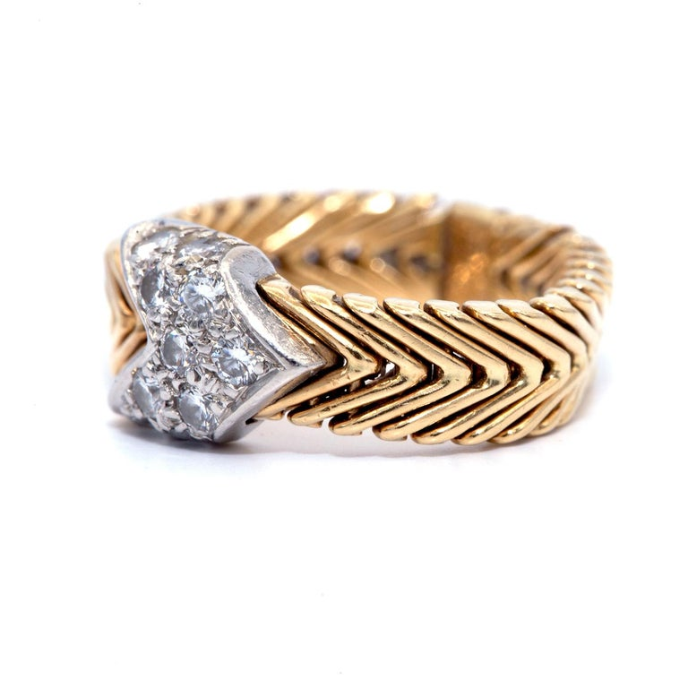 This gold braided band was designed by Paloma Picasso for Tiffany & Co. in the 1980s. Paloma Picasso for Tiffany 18-Karat Chevron Woven Gold Ring with Diamond Arrow A design Classic by Paloma Picasso for Tiffany and Co. of a flexible 18-karat gold