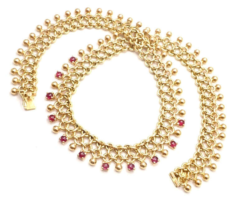 18k Yellow Gold Vintage Ruby Collar Necklace by Tiffany Co. With 11 round rubies total weight approximately 5ct Details:  Length: 16
